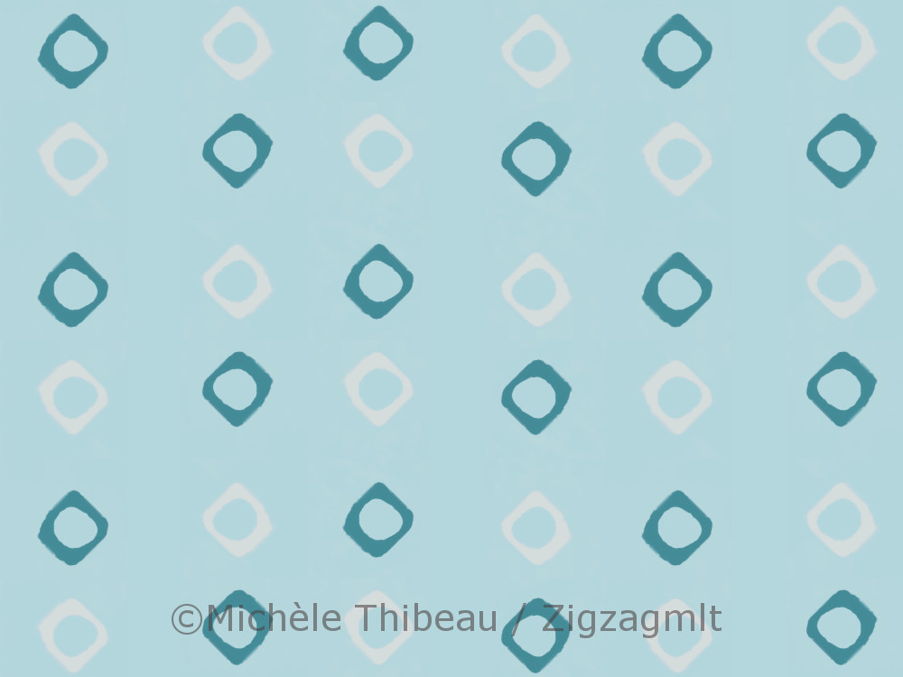 The same muted sky-blur background. Two-tone, white and blue diamond-shaped painted polka dots.